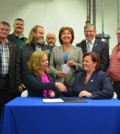 Coralee Oakes, B.C. Minister of Community, Sport and Cultural Development (left) and Lori Ackerman, mayor of Fort St. John and chair of the Peace River Regional District, shake hands at the signing of the Peace River Agreement May 29. With the mayors of the Peace Region. Photo: Stacy Thomas
