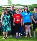 Organizers, volunteers and athletes take a break from a busy day of golfing during the 17th annual Special Olympics Charity Golf Tournament to smile for a photo. Photo: Bronwyn Scott