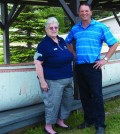 Juanita Graham, travel counsellor at Taylor's Visitor Information Centre, and former city councillor Brad Filmer stand in front of the canoe, a replica of the one Sir Alexander Mackenzie and his crew of eight men and a dog used to travel through the region in 1793. The replica was built by longtime Taylor resident Glen Kyllo, who has since passed away. Photo: Bronwyn Scott