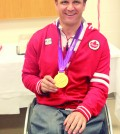 "Robert ""Bo"" Hedges displays his gold medal he received in London, 2012. File photo"