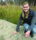 Carina Helm with her tyrannosaur track find near Tumbler Ridge. Photo: Submitted