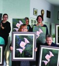 Group shows off the finished paintings. Photo: Julia Lovett
